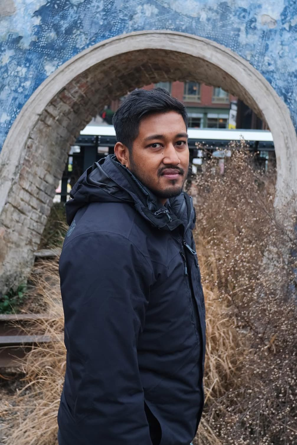 fahad jafarulla in high line nyc with blue arch wall
