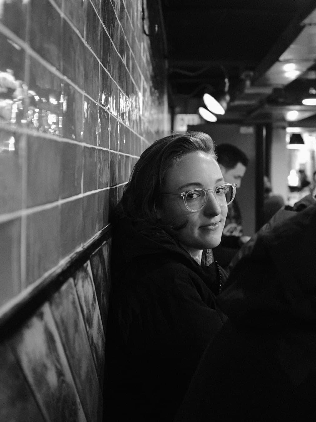 patron at miznon chelsea market nyc looking over
