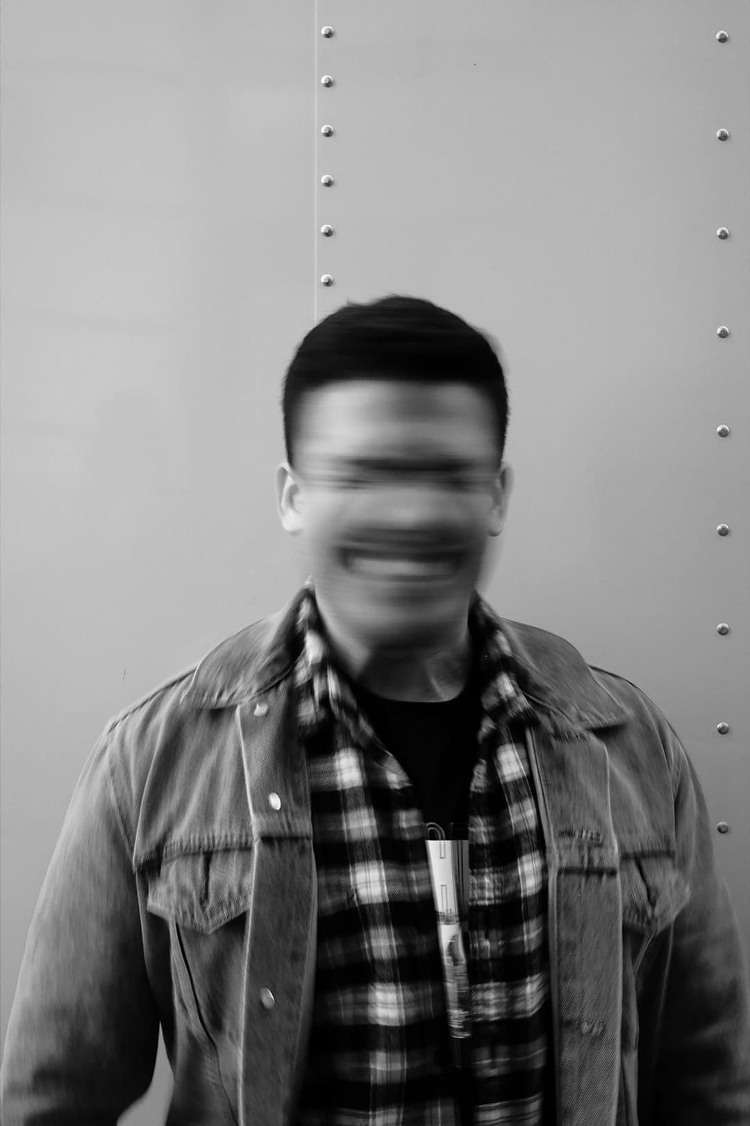 joe balzac in front of a truck shaking his head, photographed at a low shutter speed to show blur